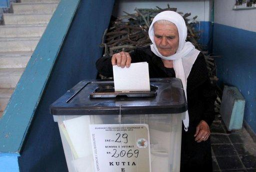 An Albanian woman casts her vote at a polling station in the village of Fushas, near Tirana, on June 23, 2013. A shootout that killed an opposition activist cast a shadow over Albania's crucial general election on Sunday, with both sides claiming victory in a vote that could determine whether one of Europe's poorest countries has a chance of joining the EU