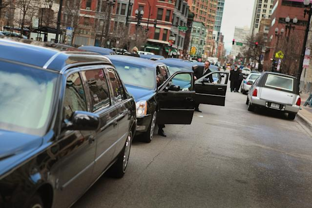 CHICAGO, IL - APRIL 08: Mourners leave Holy Name Cathedral following a funeral service for film critic Roger Ebert April 8, 2013 in Chicago, Illinois. Ebert died April 4, at the age of 70, after a long battle with cancer. (Photo by Scott Olson/Getty Images)