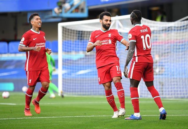 Roberto Firmino, left, Mohamed Salah, centre and Sadio Mane, right, have not had cause for celebration lately (Michael Regan/PA)