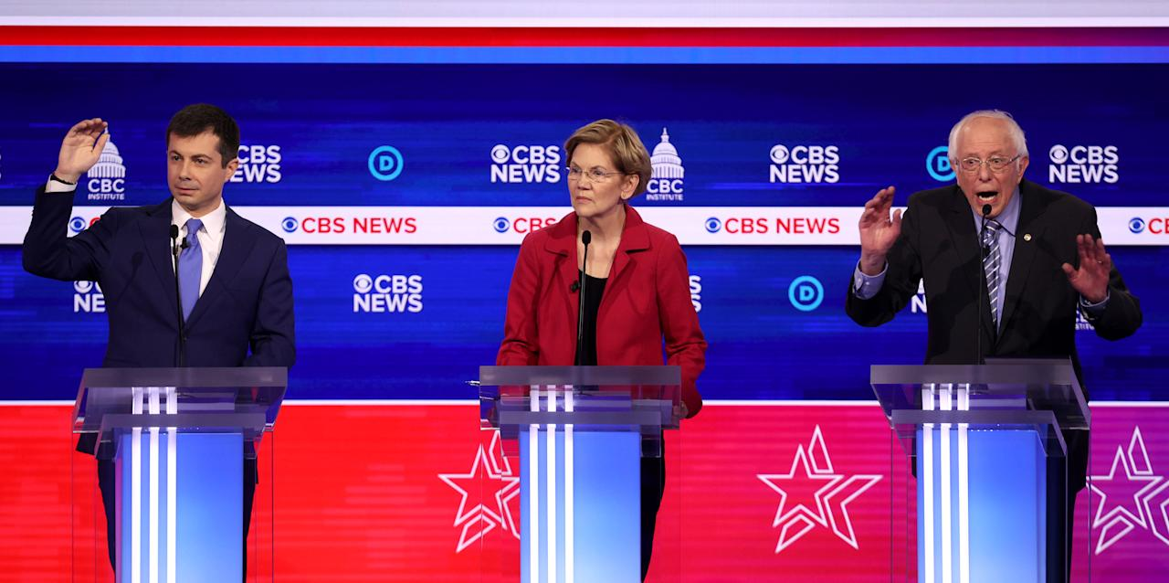 CHARLESTON, SOUTH CAROLINA - FEBRUARY 25: Democratic presidential candidates (L-R) former South Bend, Indiana Mayor Pete Buttigieg, Sen. Elizabeth Warren (D-MA), and Sen. Bernie Sanders (I-VT) participate the Democratic presidential primary debate at the Charleston Gaillard Center on February 25, 2020 in Charleston, South Carolina. Seven candidates qualified for the debate, hosted by CBS News and Congressional Black Caucus Institute, ahead of South Carolina's primary in four days.  (Photo by Win McNamee/Getty Images)