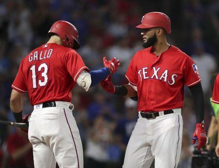 May 25, 2018; Arlington, TX, USA; Texas Rangers right fielder Nomar Mazara (30) celebrates with left fielder Joey Gallo (13) after hitting a home run during the fifth inning against the Kansas City Royals at Globe Life Park in Arlington. Mandatory Credit: Kevin Jairaj-USA TODAY Sports