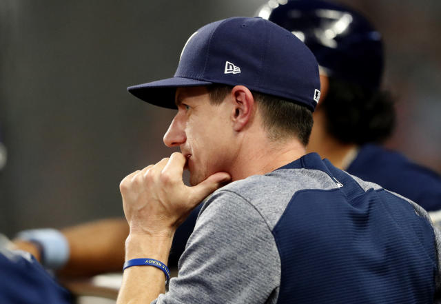 Milwaukee Brewers manager Craig Counsell watches from the dugout during a baseball game against the Atlanta Braves, Friday, Aug. 10, 2018, in Atlanta. (AP Photo/John Bazemore)