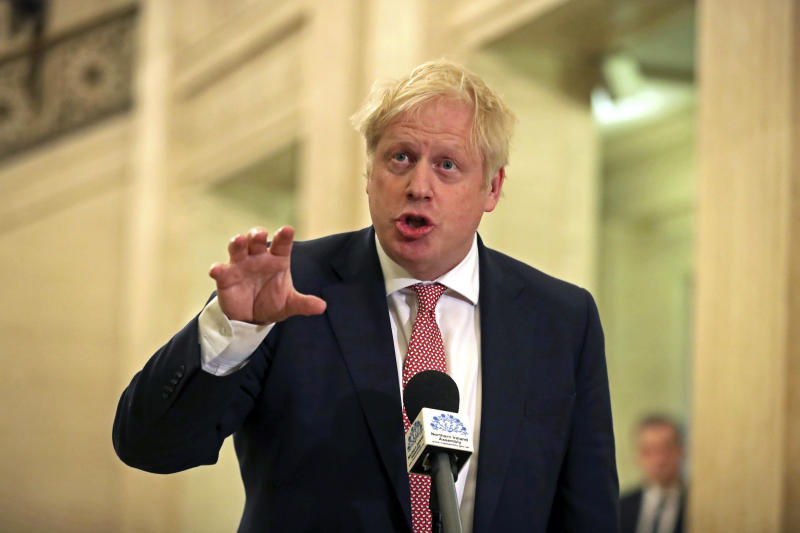 Britain's Prime Minister Boris Johnson, speaks in the Parliament Buildings at Stormont, Belfast, Northern Ireland, Monday Jan. 13, 2020, as the power sharing Northern Ireland assembly starts up. (Liam McBurney/PA via AP)