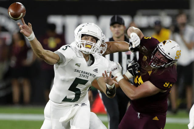 Sacramento State quarterback Kevin Thomson (5) throws a pass against Arizona State during the first half of an NCAA college football game Friday, Sept. 6, 2019, in Tempe, Ariz. (AP Photo/Matt York)