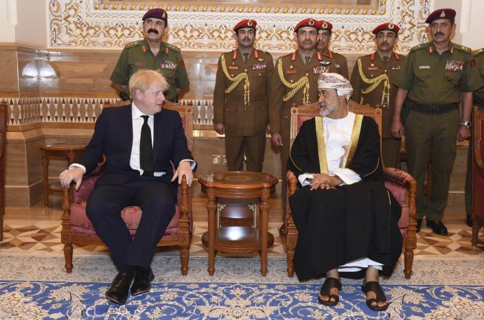 In this photo made available by Oman News Agency, Oman's new sultan Haitham bin Tariq Al Said, right, receives Britain's Prime Minister Boris Johnson after his arrival to attend an official mourning ceremony for the late Sultan Qaboos, in Muscat, Oman, Sunday, Jan. 12, 2020. (Oman News Agency via AP)