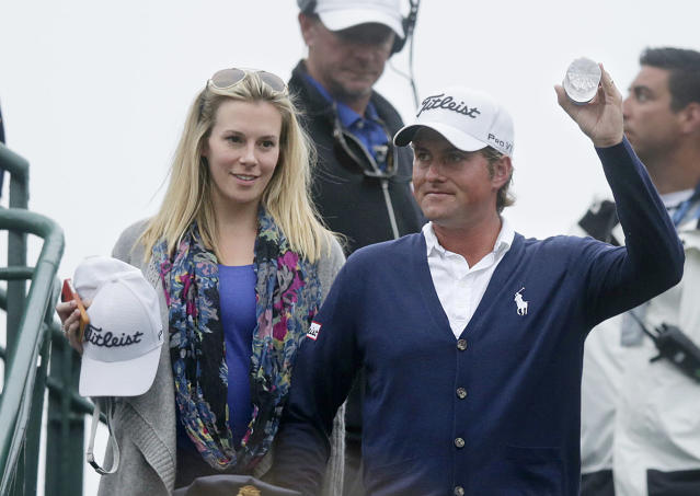 Webb Simpson and wife Dowd react after the fourth round of the U.S. Open Championship golf tournament Sunday, June 17, 2012, at The Olympic Club in San Francisco. (AP Photo/Charlie Riedel)