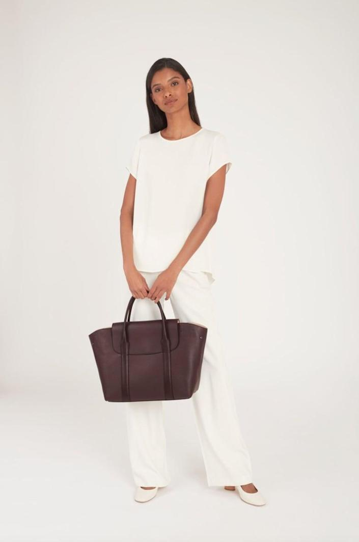 <p>This <span>Cuyana Trapeze Satchel</span> ($395) features so many useful pockets inside, including a slot specifically for your laptop.</p>
