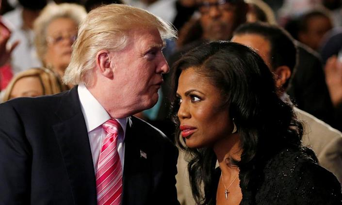 <span>Donald Trump and Omarosa Manigault (now Manigault Newman) attend a church service in Detroit in September 2016.</span> <span>Photograph: Carlo Allegri/Reuters</span>