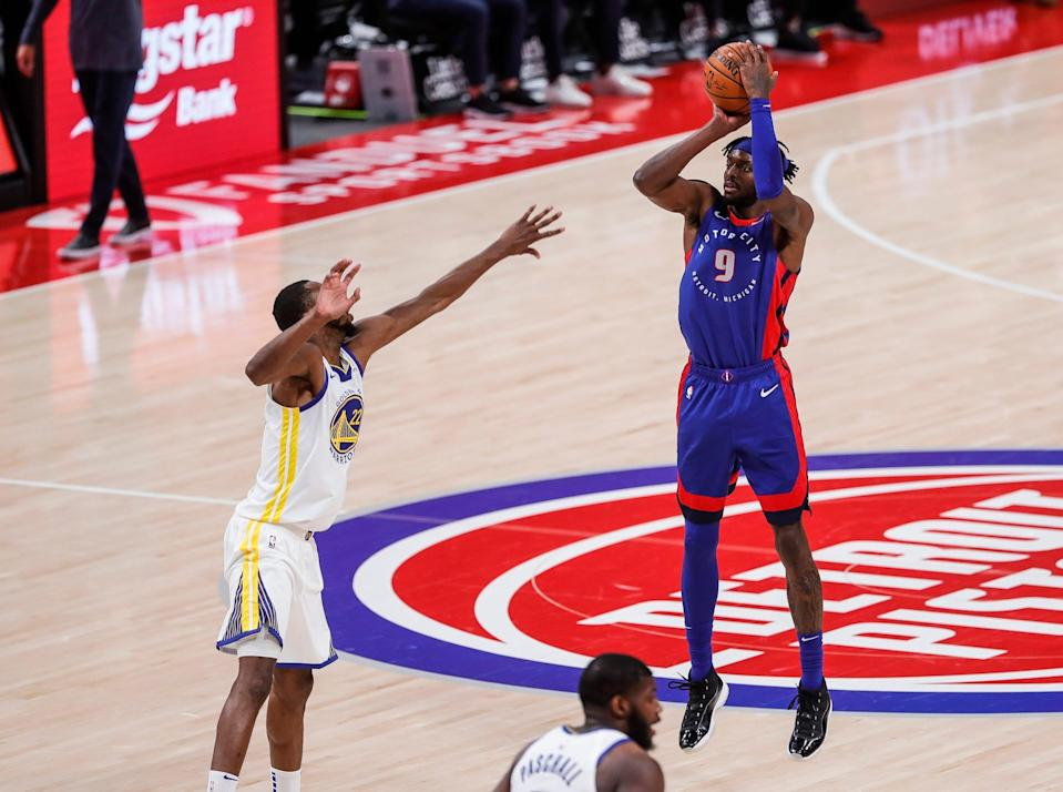 Detroit Pistons forward Jerami Grant shots a 3-pointer against the Golden State Warriors during the first half at Little Caesars Arena, Tuesday, Dec. 29, 2020.