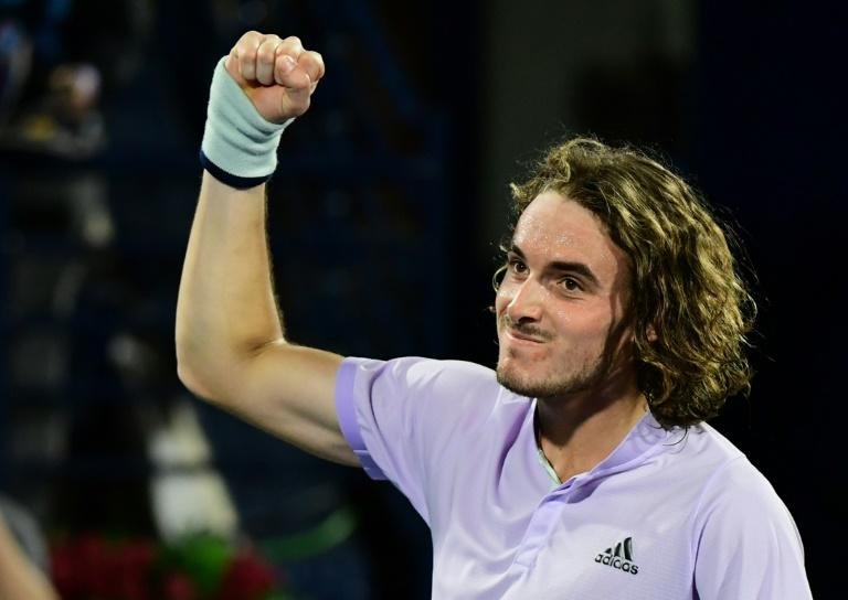 Stefanos Tsitsipas celebrates reaching the semi-finals on Thursday