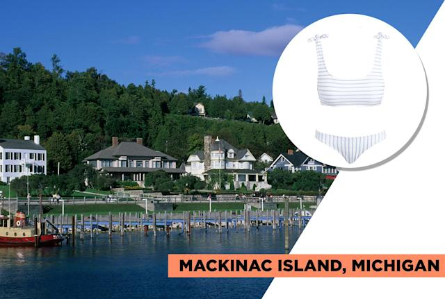 "<p>The No. 1 summer destination value is Mackinac Island in Michigan. Here's where you'll find delicious fudge stores and candy-colored art galleries and boutiques right by the water. You can book a carriage ride around town, go horseback riding, golfing, kayaking, and more. Andie Swim's candy-colored striped baby-blue bikini set is the perfect look to complement this old-timey seaside town. (Photo: Getty Images, Art: Quinn Lemmers for Yahoo Lifestyle)<br><br>Andie Swim — The San Sebastian Top, $50, <a href=""https://andieswim.com/the-san-sebastian-top-blue/"" rel=""nofollow noopener"" target=""_blank"" data-ylk=""slk:andieswim.com"" class=""link rapid-noclick-resp"">andieswim.com</a><br> Andie Swim — La Playa Bikini Bottom, $45, <a href=""https://andieswim.com/la-playa-bikini-bottom-blue/"" rel=""nofollow noopener"" target=""_blank"" data-ylk=""slk:andieswim.com"" class=""link rapid-noclick-resp"">andieswim.com</a> </p>"