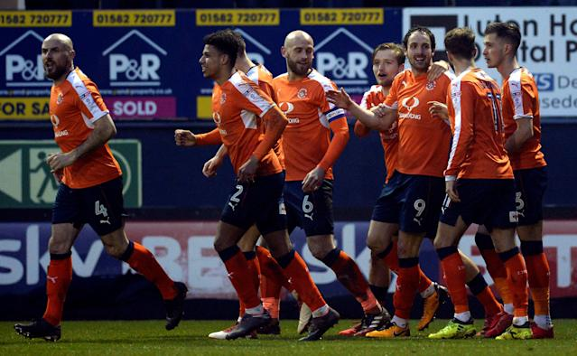 "Soccer Football - League Two - Luton Town vs Barnet - Kenilworth Road, Luton, Britain - March 24, 2018 Luton Town's Danny Hylton celebrates scoring their first goal with teammates Action Images/Adam Holt EDITORIAL USE ONLY. No use with unauthorized audio, video, data, fixture lists, club/league logos or ""live"" services. Online in-match use limited to 75 images, no video emulation. No use in betting, games or single club/league/player publications. Please contact your account representative for further details."