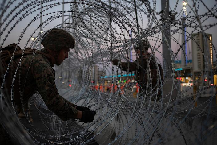 Marines fortify concertina wire along the San Ysidro Port of Entry border crossing near Tijuana on Nov. 20, 2018. (Photo: Adrees Latif/Reuters)