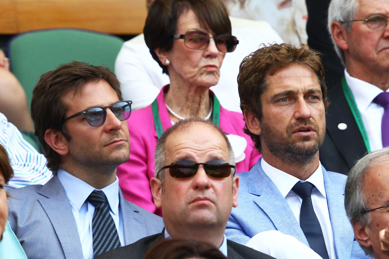 LONDON, ENGLAND - JULY 07: Bradley Cooper and Gerard Butler attend the Gentlemen's Singles Final match between Andy Murray of Great Britain and Novak Djokovic of Serbia on day thirteen of the Wimbledon Lawn Tennis Championships at the All England Lawn Tennis and Croquet Club on July 7, 2013 in London, England. (Photo by Clive Brunskill/Getty Images)