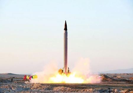 A new Iranian precision-guided ballistic missile is launched as it is tested at an undisclosed location