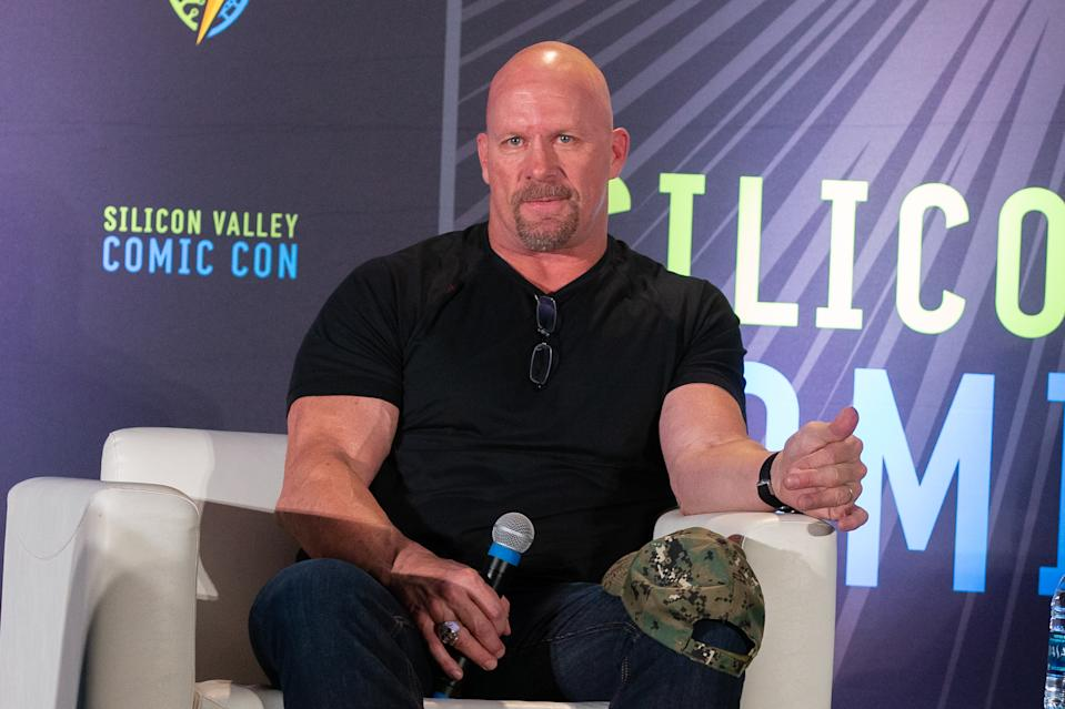 Stone Cold Steve Austin isn't here for people criticizing his mask. (Photo by Bill Watters/Getty Images)