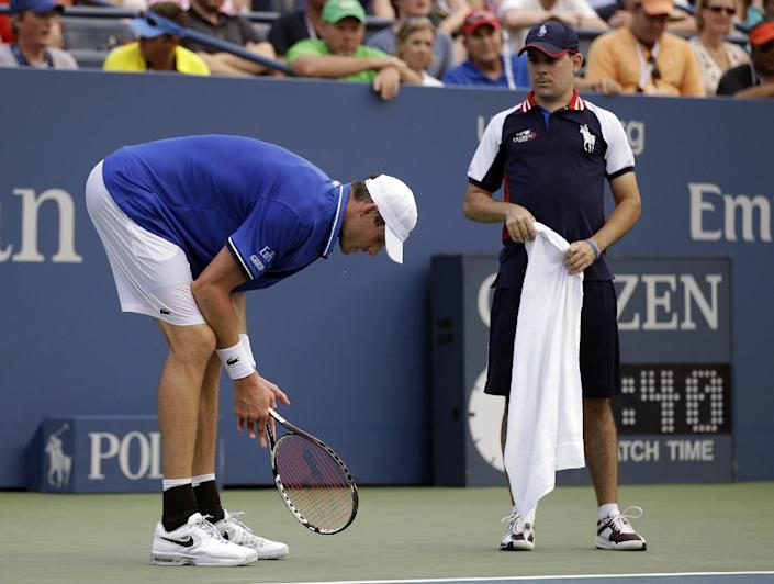 John Isner reacts after losing a point to Philipp Kohlschreiber, of Germany, during the third round of the 2013 U.S. Open tennis tournament, Saturday, Aug. 31, 2013, in New York. (AP Photo/Darron Cummings)