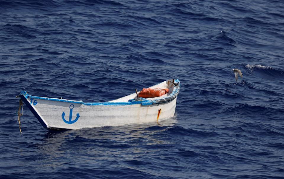 An abandoned wooden boat found by a German charity migrant rescue ship off the North African coast (REUTERS)