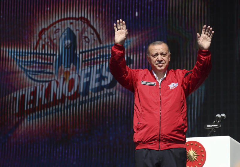 Turkey's President Recep Tayyip Erdogan salutes his supporters at a technology fair in Istanbul, Saturday, Sept. 21, 2019. Erdogan expressed frustration with what he said was the United States' continued support to Syrian Kurdish forces that Turkey regards as terrorists and reiterated that Turkey had completed all preparations for a possible unilateral military operation in northeast Syria, along the Turkish border east of the Euphrates River.(Presidential Press Service via AP, Pool)