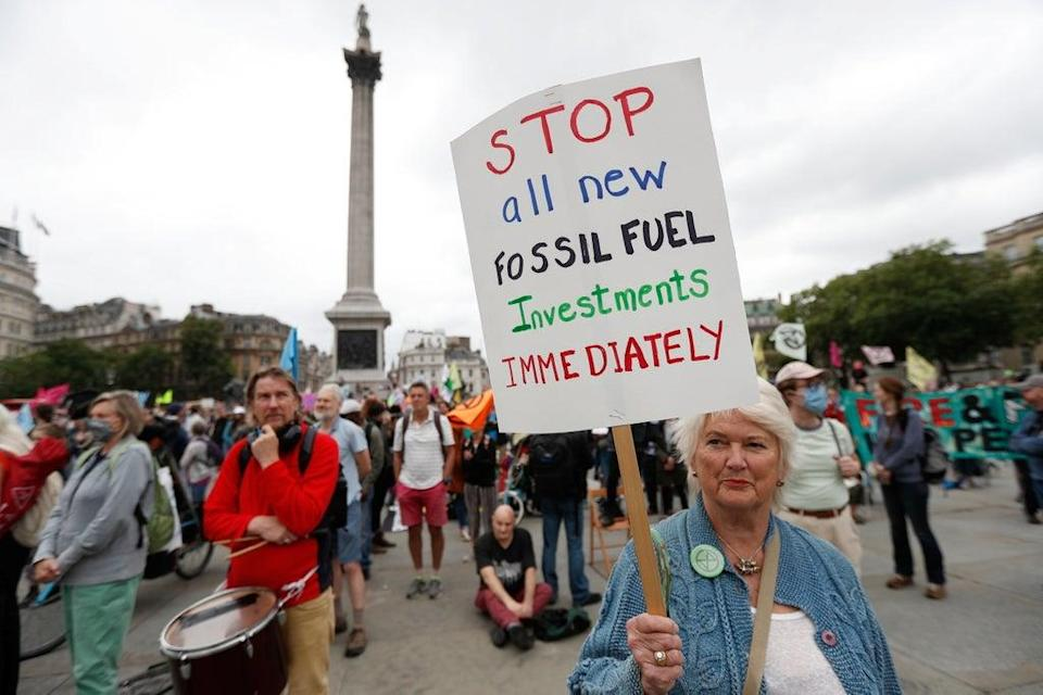 A demonstrator holds a sign during a protest of Extinction Rebellion climate activists at Trafalgar Square (REUTERS)