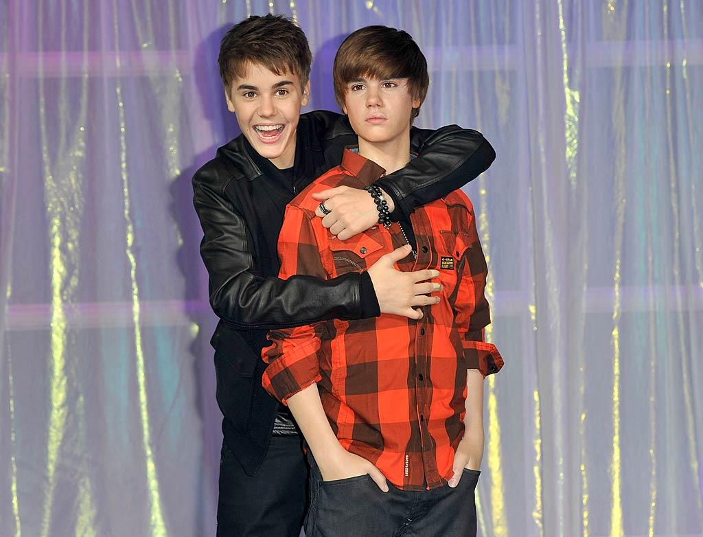"Justin Bieber came face to face with his doppelganger -- who was still sporting the pint-sized pop star's signature 'do -- when he unveiled his very own waxwork at Madame Tussauds in London on Tuesday. Do you think the statue is a good likeness of the ""Baby"" singer? Gareth Cattermole/<a href=""http://www.gettyimages.com/"" target=""new"">GettyImages.com</a> - March 15, 2011"