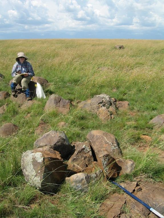 Lisa Cappelli at an outcrop of gabbronorite at the Vredefort impact crater.