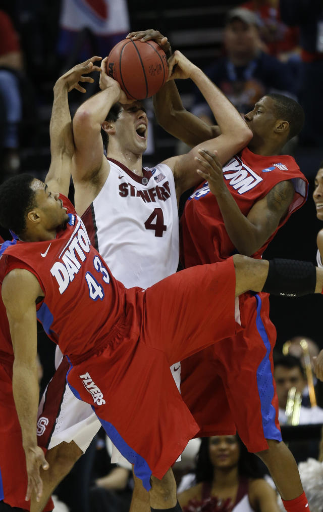 Dayton guard Vee Sanford, left and Dayton guard Jordan Sibert, right defend against Stanford center Stefan Nastic (4) during the second half in a regional semifinal game at the NCAA college basketball tournament, Thursday, March 27, 2014, in Memphis, Tenn. (AP Photo/John Bazemore)