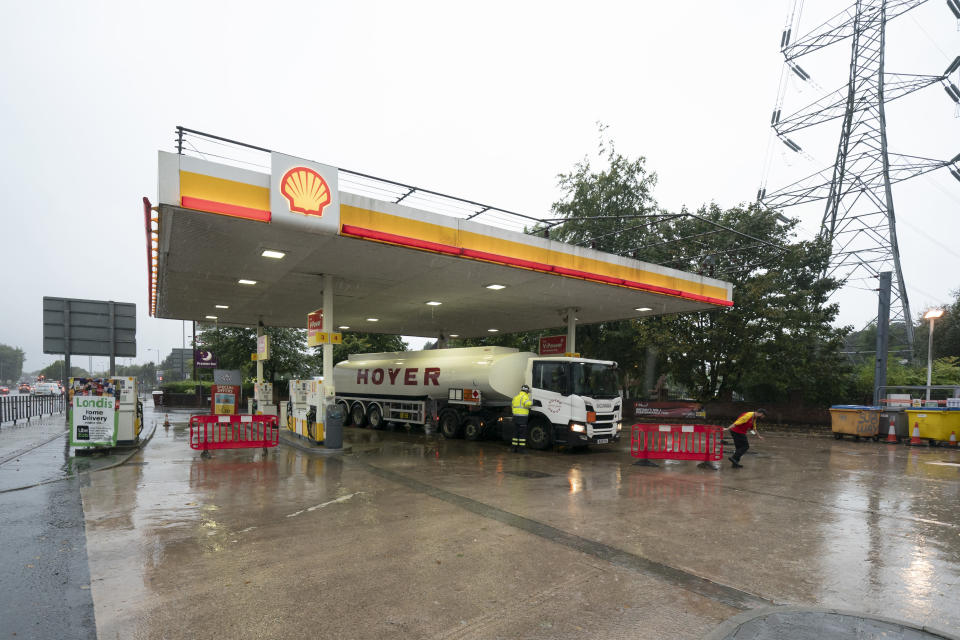 A fuel delivery is made to a petrol station in Manchester which had run out of fuel after an outbreak of panic buying in the UK, Monday, Sept. 27, 2021. British Prime Minister Boris Johnson is said to be considering whether to call in the army to deliver fuel to petrol stations as pumps ran dry after days of panic buying. ( AP Photo/Jon Super)