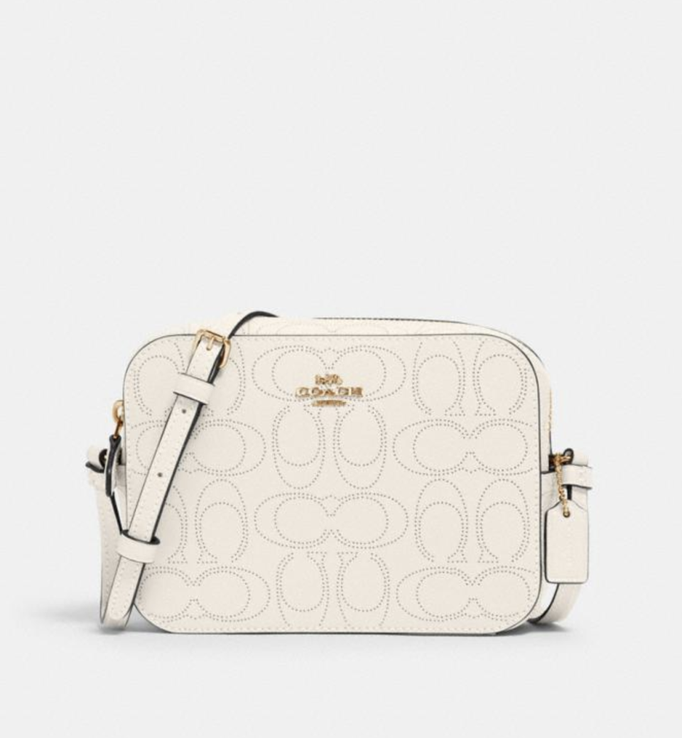 Mini Camera Bag In Signature Leather in Chalk (Photo via Coach Outlet)