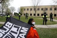 Demonstrators confront police following an officer-involved killing in Brooklyn Center, Minnesota