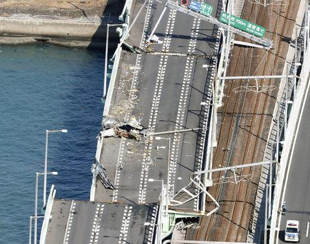 A bridge connecting Kansai airport, damaged by crashing with a 2,591-tonne tanker, which is sent by strong wind caused by Typhoon Jebi, is seen in Izumisano, western Japan, in this photo taken by Kyodo September 5, 2018. Mandatory credit Kyodo/via REUTERS