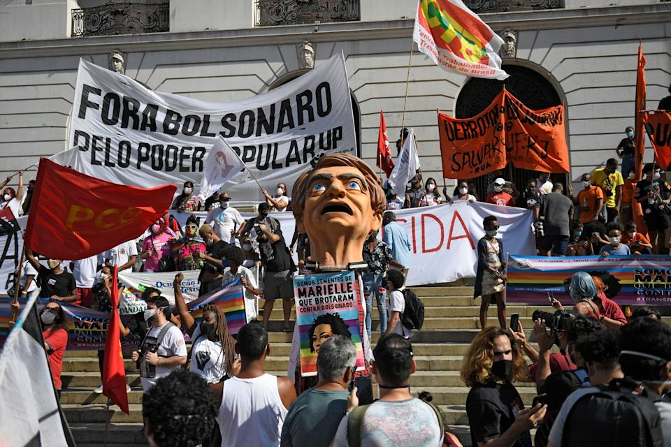 <p>People take part in a protest against Brazilian President Jair Bolsonaro's handling of the COVID-19 pandemic in downtown Rio de Janeiro, Brazil on May 29, 2021. (Photo by MAURO PIMENTEL / AFP) (Photo by MAURO PIMENTEL/AFP via Getty Images)</p>