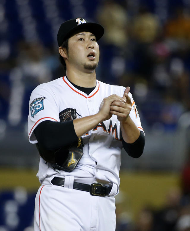 Miami Marlins' Junichi Tazawa, of Japan, prepares to pitch during the fourth inning of a baseball game against the Los Angeles Dodgers, Thursday, May 17, 2018, in Miami. (AP Photo/Wilfredo Lee)