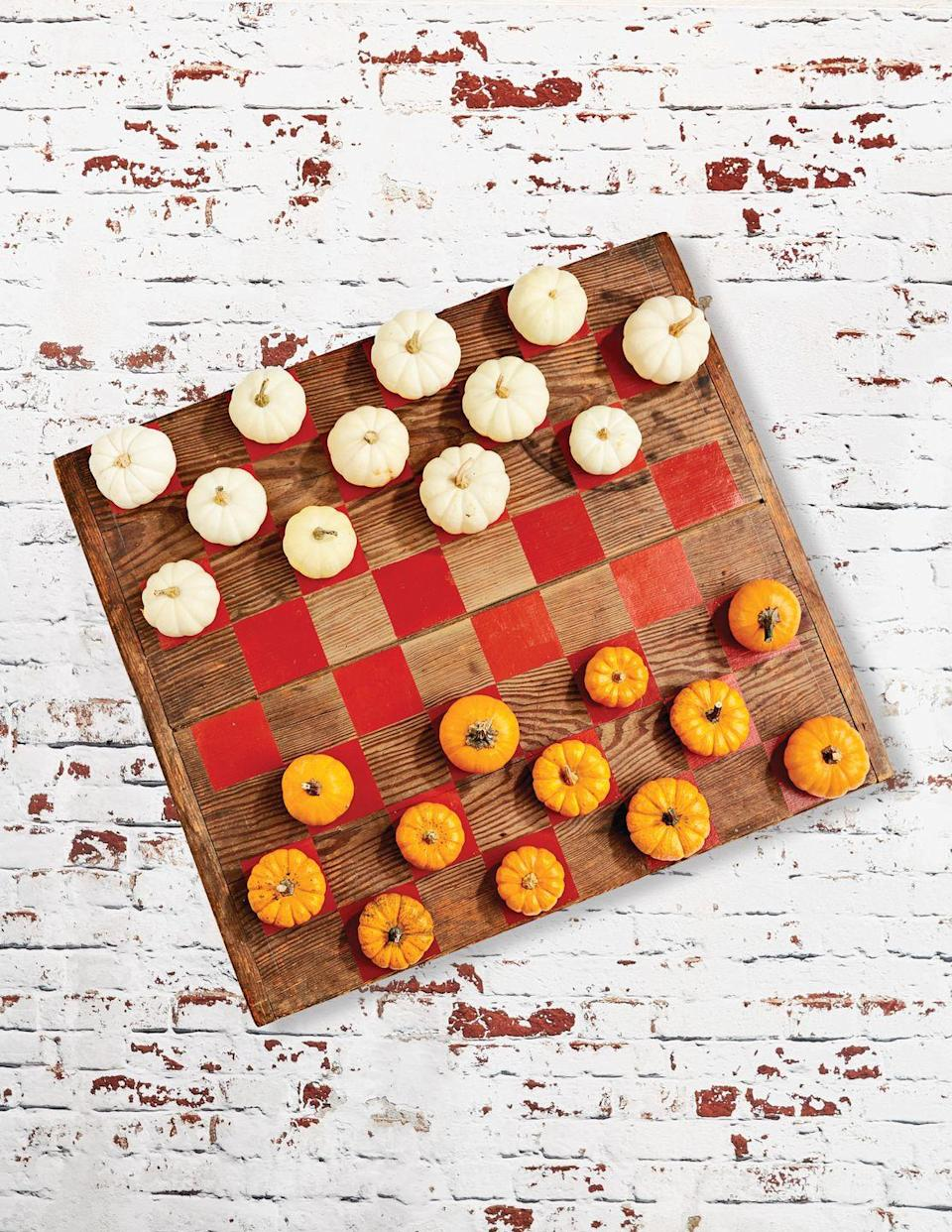 <p>Fall's a whole lot more fun when you can play <em>with</em> it, not just in it! These checkers allow you to do just that. The whole project is such a fun alternative to the store-bought version.</p><p><strong>Make the game:</strong> Paint 32 squares on a large (roughly 30-inch) wood board with burnt orange craft paint. Use mini white and orange pumpkins as game pieces. </p>