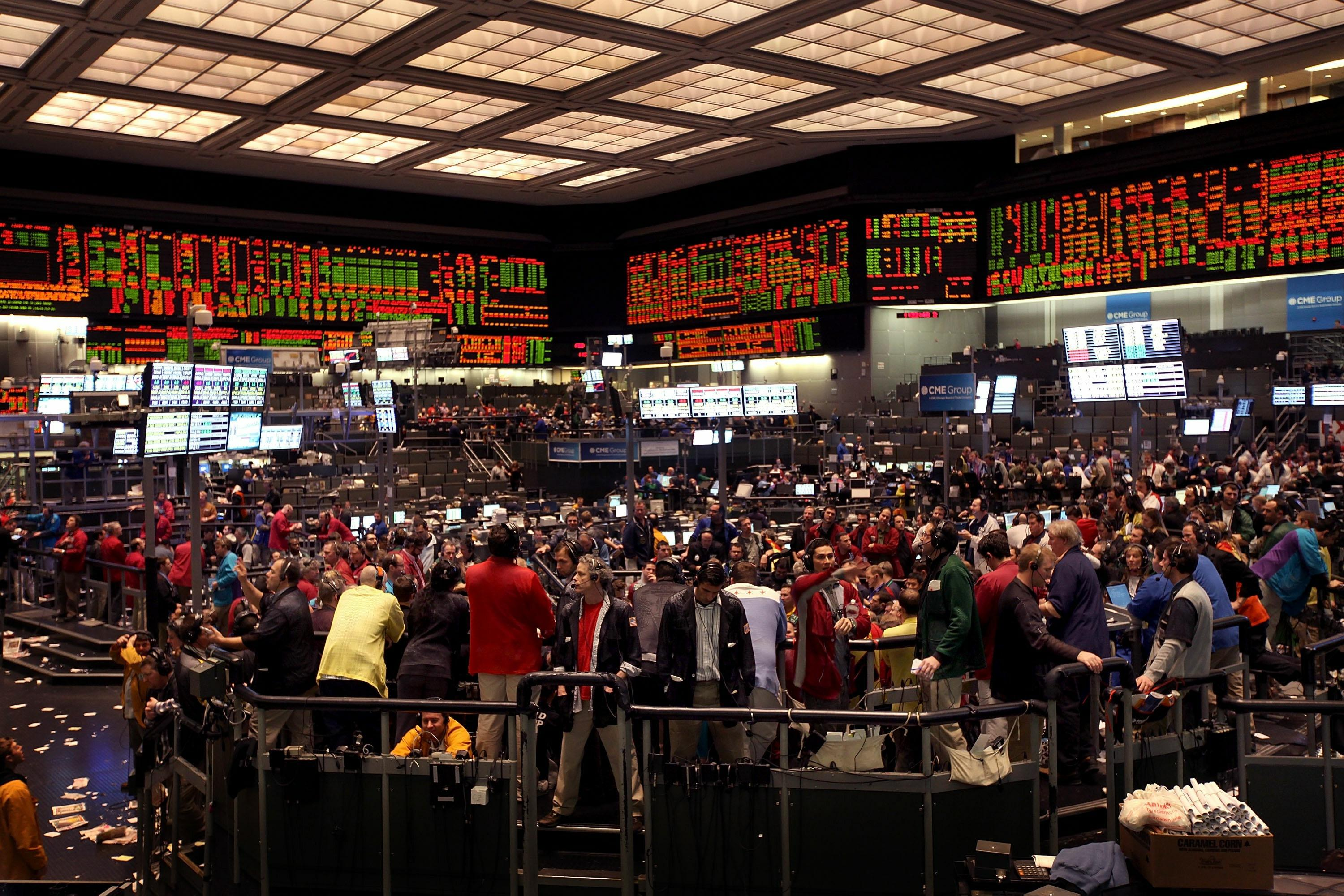 Traders work on the trading floor at the CME Group on February 11, 2011. (Photo by Scott Olson/Getty Images)