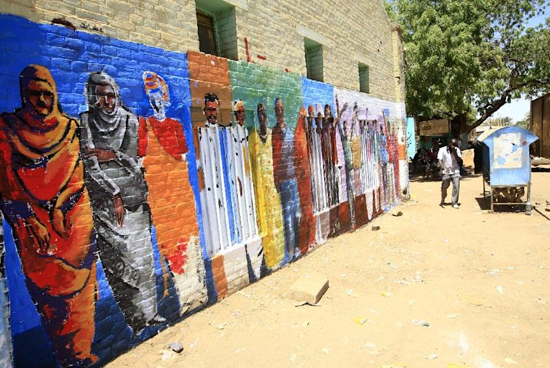 A mural on a Khartoum wall shows some of the more than 60 demonstrators who have been killed by the security forces during efforts to crush the protests (AFP Photo/Ebrahim Hamid)