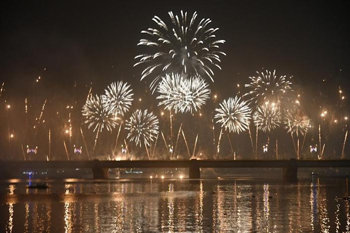 Fireworks explode over a river during New Year celebrations in Abidjan, Ivory Coast (AFP Photo/Sia Kambou)