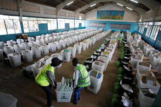 <p>Election officials from the Independent Electoral and Boundaries Commission (IEBC) arrange ballot boxes and election material at a holding center before distribution to polling centers, in Nairobi, Kenya, Aug. 7, 2017. (Photo: Baz Ratner/Reuters) </p>