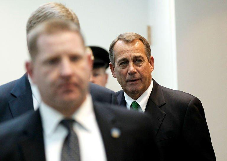 "House Speaker John Boehner emerges from a meeting with House Republicans at the US Capitol on January 1, 2013 in Washington. After a day of twisting political drama, the US Congress was expected to finally endorse a deal to avert the ""fiscal cliff"" budget crisis that had threatened to unleash a new recession"