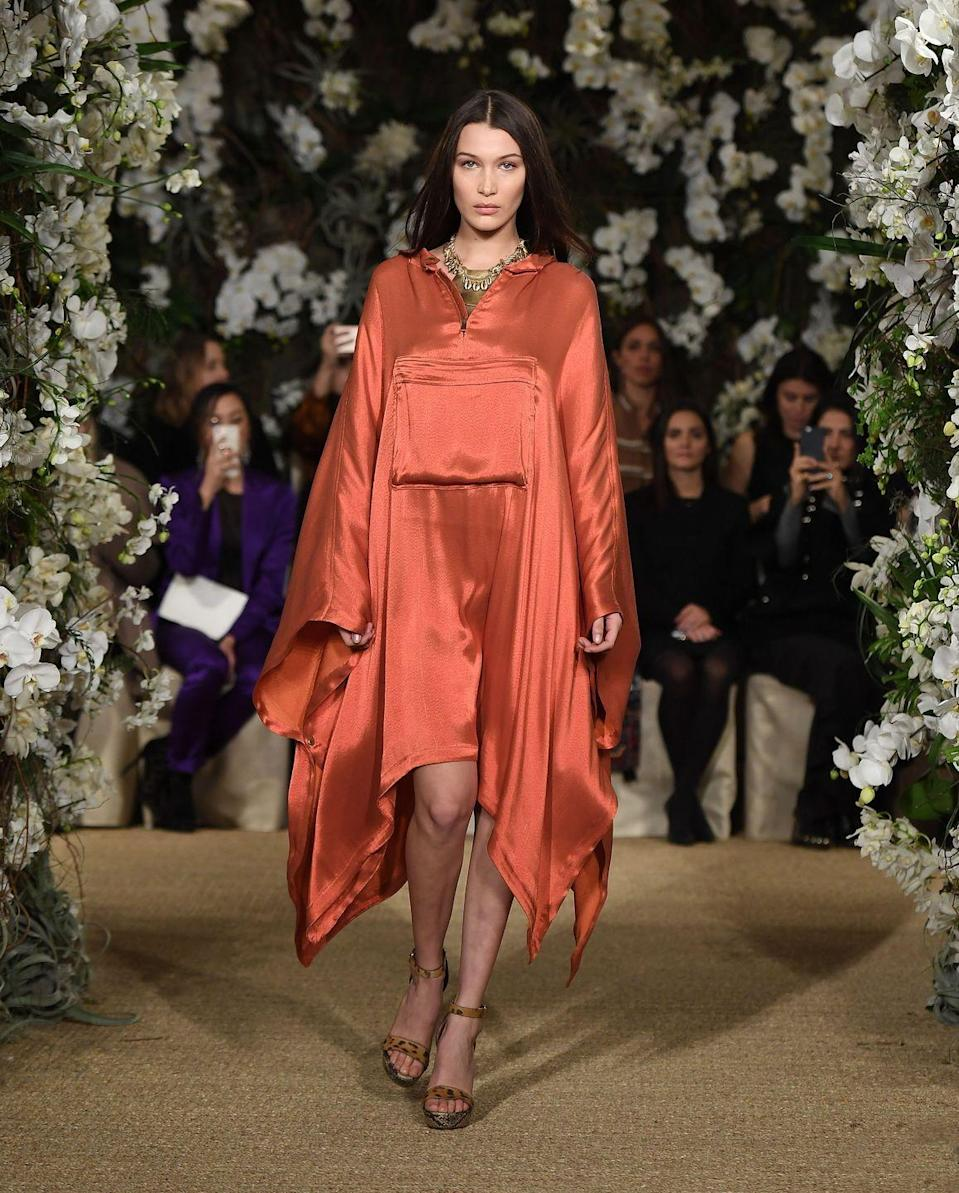 <p>Bella Hadid walked Ralph Lauren's AW17 NYFW show in a burnt orange parachute dress</p>