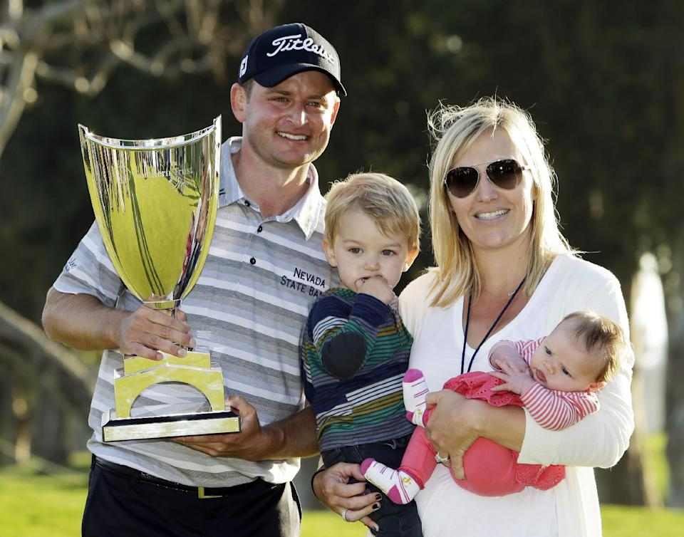 John Merrick, left, poses with the his wife Jody and their children Chase, 1, and Gemma, 1 month old, after his victory in the Northern Trust Open golf tournament at Riviera Country Club in the Pacific Palisades area of Los Angeles, Sunday, Feb. 17, 2013. (AP Photo/Reed Saxon)