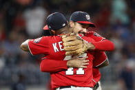 Washington Nationals third baseman Anthony Rendon (6) and first baseman Howie Kendrick (47) embraces as they celebrate defeating the Atlanta Braves 5-3 in a baseball game Saturday, July 20, 2019, in Atlanta. (AP Photo/John Bazemore)