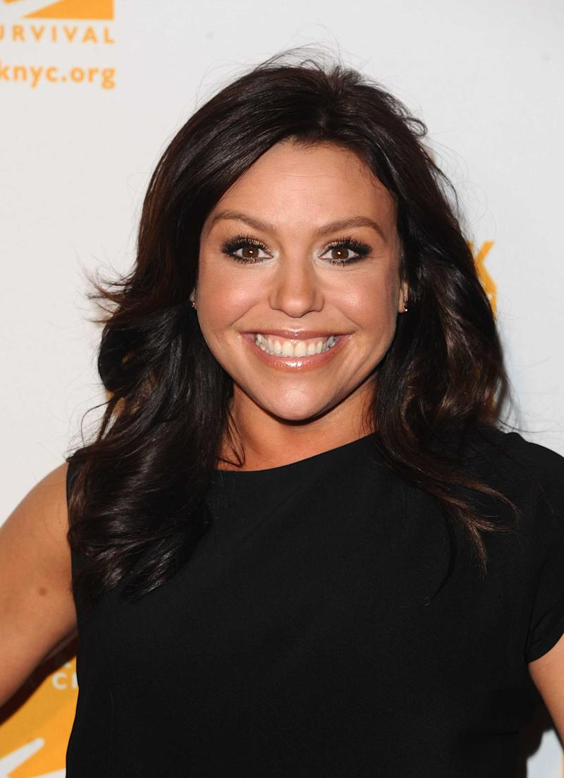 REPLACES SECOND LINE AS THE DEAL IS NOT YET COMPLETE.  FILE-  This Thursday, April 7, 2011 file photo shows Rachael Ray at the Food Banks Can Do Awards gala in New York. The parent company of Reader's Digest is working on a deal to sell Rachael Ray's cooking magazine Every Day with Rachael Ray to Meredith Corp., publisher of Better Homes and Gardens, Family Circle, Parents and Fitness.    (AP Photo/Peter Kramer, FILE)