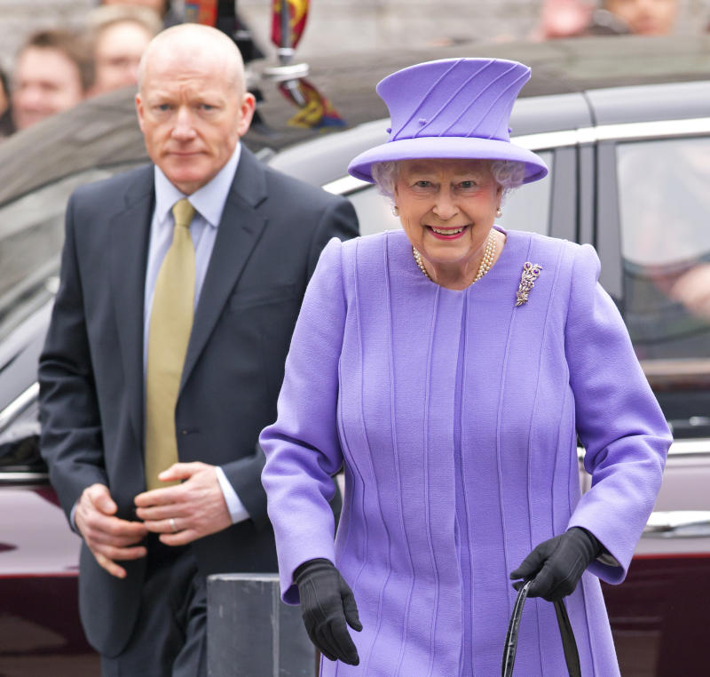 LONDON, UNITED KINGDOM - FEBRUARY 27: (EMBARGOED FOR PUBLICATION IN UK NEWSPAPERS UNTIL 48 HOURS AFTER CREATE DATE AND TIME) Queen Elizabeth II, flanked by her Police Protection Officer, arrives to open the new National Centre for Bowel Research and Surgical Innovation at Queen Mary, University of London on February 27, 2013 in London, England. (Photo by Indigo/Getty Images)