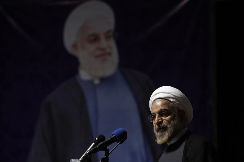 In this picture taken on May 2, 2013, Iranian President Hasan Rouhani delivers a sppech during his campaign for the presidential election in Tehran, Iran. The U.N. has slotted the new moderate-leaning president to address the global gathering of leaders on Sept. 24 - just hours after U.S. President Barack Obama is scheduled to wrap up his speech. (AP Photo/Vahid Salemi)