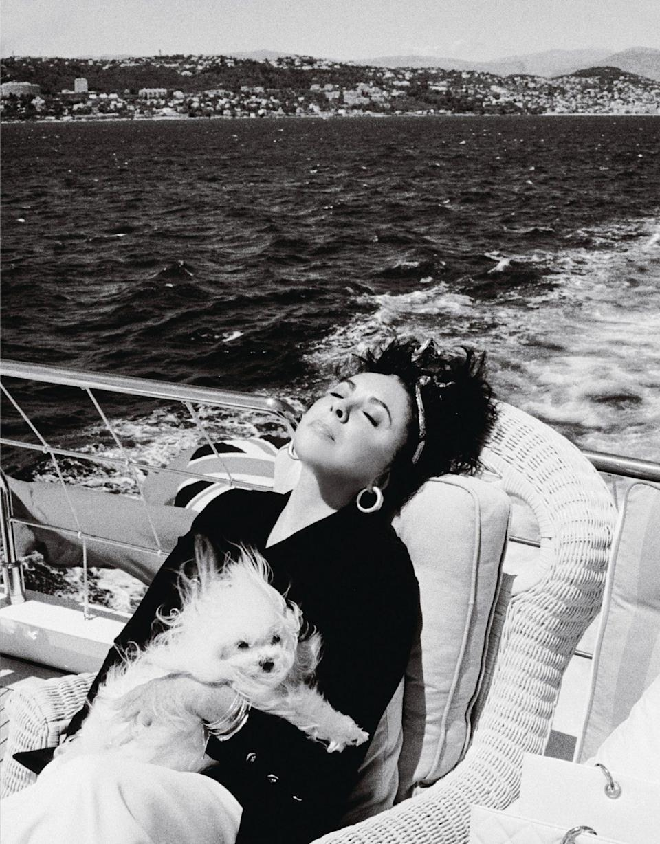 "<p>""I'd never seen her so relaxed,"" says Zahedi of the star (in Cannes with Sugar, her Maltese). ""So I just had to snap that one."" </p>"