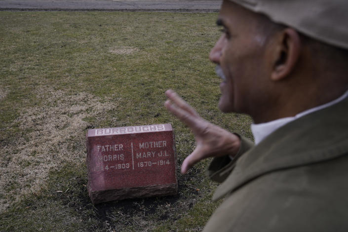 """Tony Burroughs, CEO of Chicago's Center for Black Genealogy, talks about his family Wednesday, March 17, 2021, at the gravesite of his great-grandparents in the Oakridge Cemetery in Hillside, Ill. """"I realized they were right under my feet,"""" he said. """"I can resurrect my ancestors that are not in history books but they live. They survive….And it's up to me to tell their stories."""" (AP Photo/Charles Rex Arbogast)"""