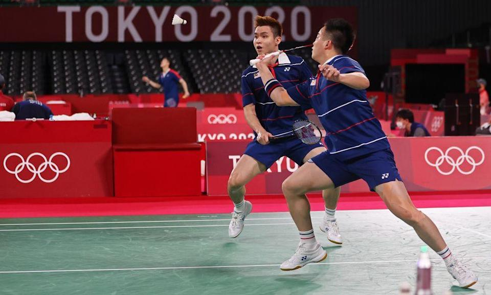 Aaron Chia of Malaysia in action as Soh Wooi Yik looks on during the match against Marcus Fernaldi Gideon and Kevin Sanjaya Sukamuljo of Indonesia at the Musashino Forest Sport Plaza, Tokyo July 29, 2021. — Reuters pic