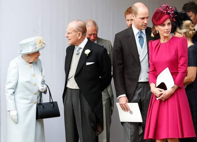The Queen, the Duke of Edinburgh and the Duke and Duchess of Cambridge leave after the wedding of Princess Eugenie of York and Jack Brooksbank in St George's Chapel, Windsor Castle