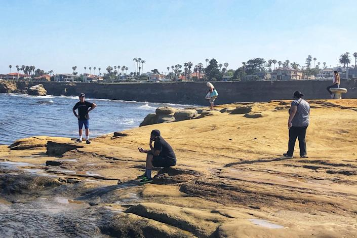 "The Sunset Cliffs area of San Diego's Point Loma drew crowds over the weekend that worried officials, but returned to calm and distancing Monday morning. San Diego's beaches are open, with restrictions. <span class=""copyright"">(Christopher Reynolds / Los Angeles Times)</span>"